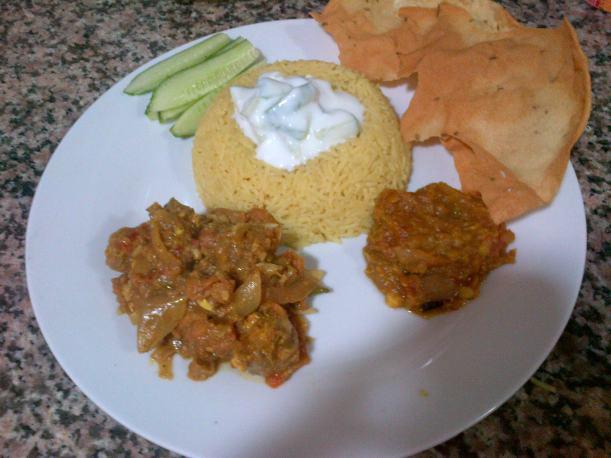 Chicken masala, daal, biryani rice, raita, pappadums